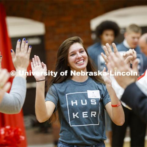 Bryn Hannan runs through a tunnel walk of high-fives at the FFA signing ceremony for current senior FFA members who have committed to Nebraska. April 3, 2019. Photo by Craig Chandler / University Communication.