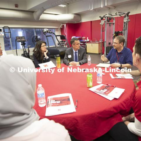 Cary Savage (center), director of Nebraska's Center for Brain, Biology and Behavior, listens to a question from Eric Olson of the Associated Press.