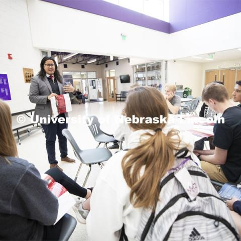 Abel Covarrubias, one of three dedicated western Nebraska recruiters, talks with interested juniors at Minden, NE, High School. April 23, 2019. Photo by Craig Chandler / University Communication.