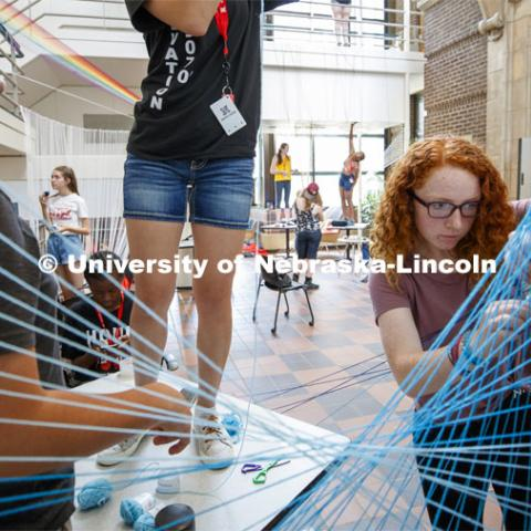 College of Architecture High School Workshop students use string to design in the atrium of the college. June 20, 2019. Photo by Craig Chandler / University Communication.