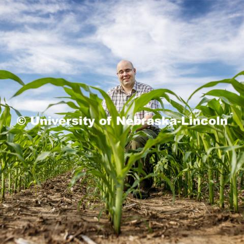 James Schnable, Assistant Professor of Agronomy and Horticulture, is sequencing crop DNA in corn to make it adapt to more specific climates. Photo used for 2018-2019 Annual Report on Research at Nebraska. July 2, 2019. Photo by Craig Chandler / University Communication.