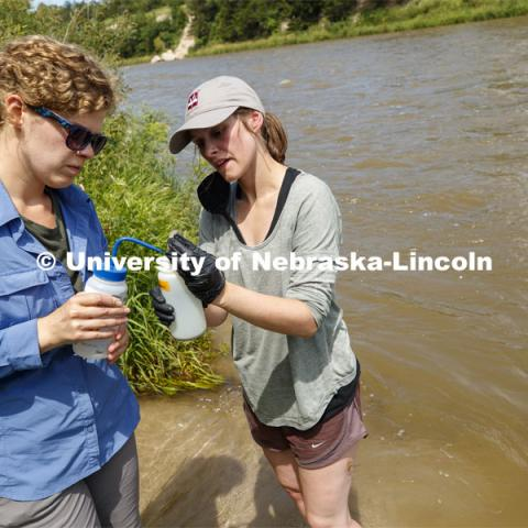 Sydney Kimnach, sophomore in environmental studies and fisheries and wildlife management, with Professor Jessica Corman research algae in the Niobrara River. Jessica Corman, assistant professor in the School of Natural Resources, UCARE research group researching algae in the Niobrara River. Fort Niobrara National Wildlife Refuge. July 13, 2019. Photo by Craig Chandler / University Communication.