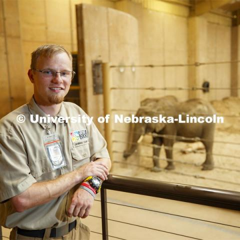 Stefan Lechnowsky, a senior Fisheries and Wildlife major at Nebraska, helps look after elephants during his internship this summer at Omaha's Henry Doorly Zoo and Aquarium after an early summer study abroad studying them in Africa. July 29, 2019. Photo by Craig Chandler / University Communication.