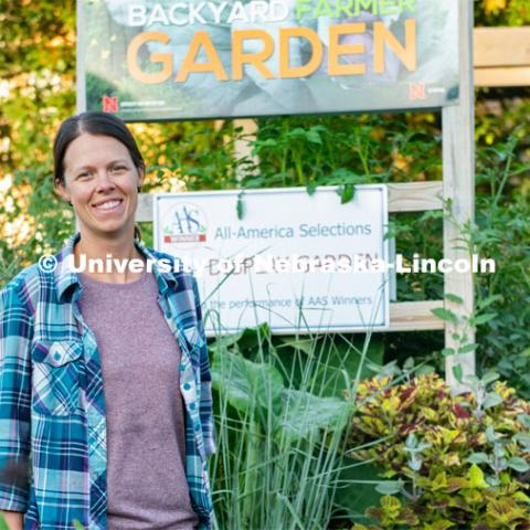 Ann Powers, a Research Technician for Agronomy and Horticulture, works in the Backyard Farmer Gardens. August 6, 2019. Photo by Gregory Nathan / University Communication.