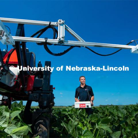 Santosh Pitla, associate professor of advanced machinery systems in the Department of Biological Systems Engineering at the University of Nebraska–Lincoln, is currently developing an autonomous tractor using ground robotics. Pitla and his team are testing their driverless tractor at the Agricultural Research and Development Center (ARDC, MEAD). The autonomous tractors are named Flexible Structured Robotic Vehicle (FlexRo), the tractor is currently used for plant phenotyping, which is measuring the physical characteristics of the plant. According to Pitla, cameras are added to the machine to collect images that characterize plant conditions. Photo for the 2019 publication of the Strategic Discussions for Nebraska magazine. July 17, 2019, Photo by Gregory Nathan / University Communication.