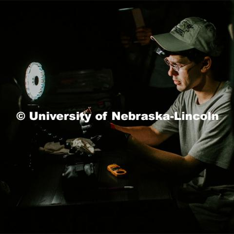 Nebraska graduate student Christopher Fill is studying the patterns of bats living at Homestead National Monument near Beatrice. Christopher working on a bat that they netted. August 19, 2019. Photo by Justin Mohling / University Communication.