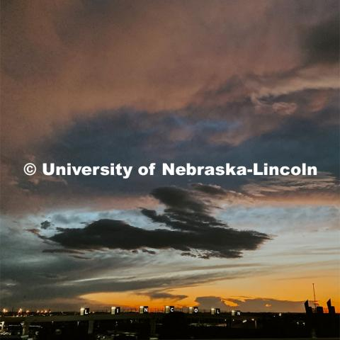 Sunset over the pedestrian bridge between Haymarket and Haymarket Park, Lincoln, Nebraska. August 19, 2019. Photo by Taylor DeMaro / University Communication.