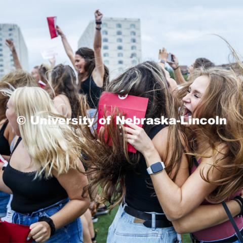 Lauryn Johnson and Allyse Kleiber celebrate after opening their bids. New sorority members celebrate their bids as they open their invitations on the intramural fields. Sorority Bid Day. August 24, 2019. Photo by Craig Chandler / University Communication.