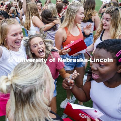 New sorority members celebrate their bids as they open their invitations on the intramural fields. Sorority Bid Day. August 24, 2019. Photo by Craig Chandler / University Communication.
