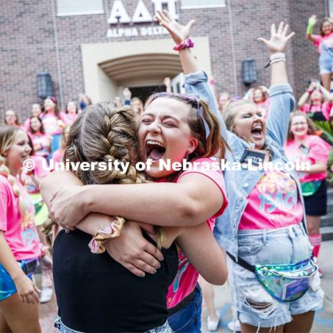 Alpha Delta Pi members celebrate outside their sorority. Sorority Bid Day. August 24, 2019. Photo by Craig Chandler / University Communication.