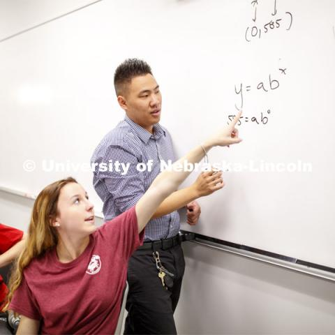 Briell Redd points how she would solve the problem Justin Nguyen has written on the board during Calculus 106 recitation in Louise Pound Hall. August 29, 2019. Photo by Craig Chandler / University Communication.