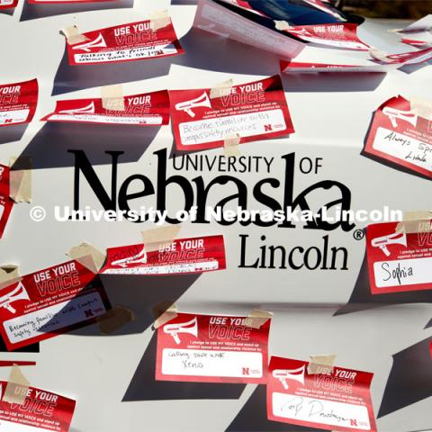 "Huskers pledged to speak out and stand up against sexual and relationship violence in the first of a three-day ""Cover the Cruiser"" initiative. The project encourages students, faculty and staff to sign a ""Use Your Voice"" pledge card and attach it to a police car. Each card signifies a commitment to help others and speak out against all forms of sexual violence. September 12, 2019. Photo by Craig Chandler / University Communication."