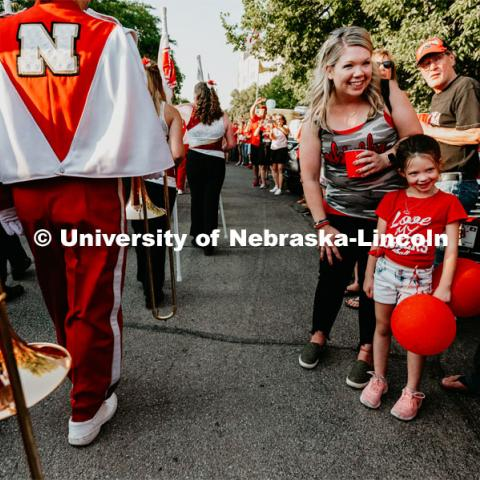 Kid excited to see The Cornhusker Marching Band march by. Nebraska vs. Northern Illinois football game. September 14, 2019. Photo by Justin Mohling / University Communication.