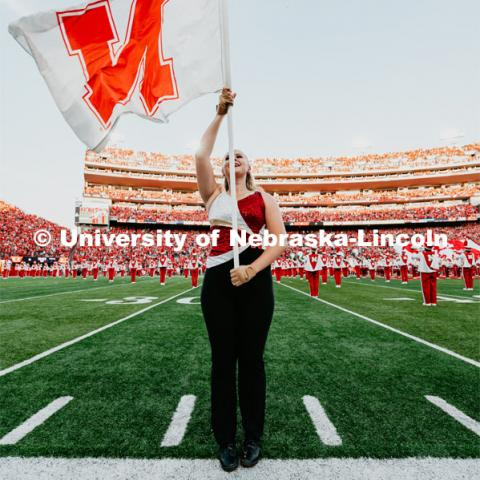 Cornhusker Marching Band Color Guard member on the field. Nebraska vs. Northern Illinois football game. September 14, 2019. Photo by Justin Mohling / University Communication.