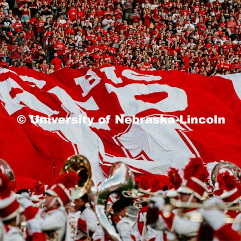 Engineering Go Big Red Flag is spread out over the fans. Nebraska vs. Northern Illinois football game. September 14, 2019. Photo by Justin Mohling / University Communication.