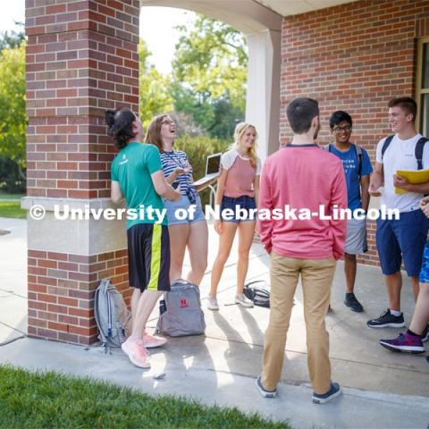 Students hanging out front of the Kauffman Academic Residential Center. Raikes school photo shoot. September 25, 2019. Photo by Craig Chandler / University Communication.