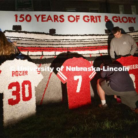 Famous Huskers are memorialized outside of Alpha Tau Omega house. Students from Alpha Tau Omega, Gamma Phi Beta, Delta Delta Delta, Acacia, Sigma Alpha Mu work on their homecoming display. 2019 Homecoming display decorations. October 3, 2019. Photo by Craig Chandler / University Communication.