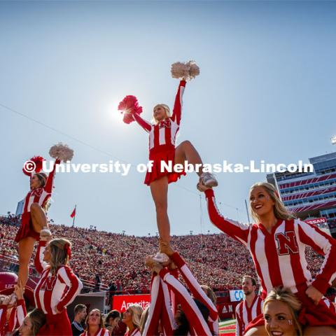 The Cheer Squad perform stunts at the Nebraska vs. Northwestern University football game. Homecoming 2019. October 5, 2019.  Photo by Craig Chandler / University Communication.