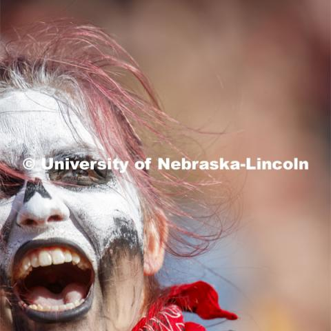Fans with faces painted like skeletons. Nebraska vs. Northwestern University football game. Homecoming 2019. October 5, 2019.  Photo by Craig Chandler / University Communication.