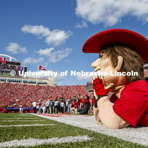 Herbie Husker watches the Scarlet dance team perform. Nebraska vs. Northwestern University football game. Homecoming 2019. October 5, 2019.  Photo by Craig Chandler / University Communication.