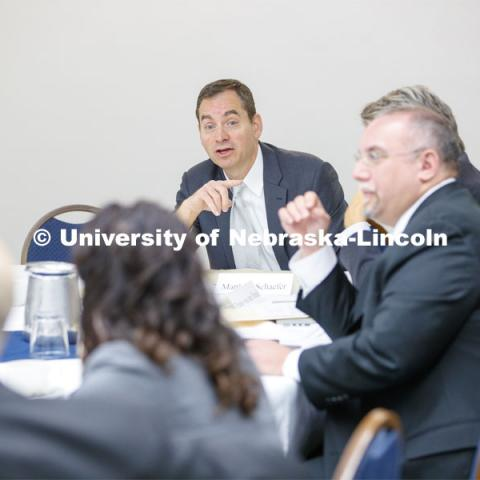 Matthew Schaefer, dark hair, and Frans von Der Dunk, both Nebraska Law professors, lead a discussion before the conference. Global Perspectives on Space Law and Policy conference in Washington D.C.  October 18, 2019. 12th Annual University of Nebraska D.C. Space Law Conference. Space, Cyber and Telecommunications Law program. Photo by Craig Chandler / University Communication.