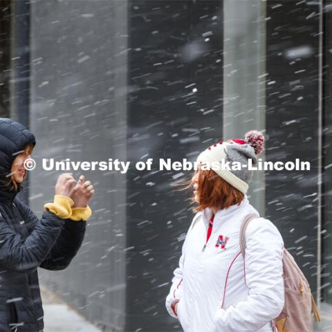 Two young women crossing campus in the snow. Snow on campus. October 30, 2019. Photo by Craig Chandler / University Communication.