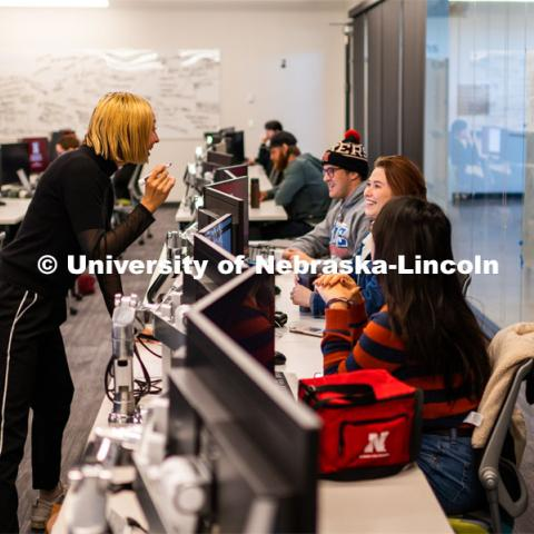 Professor Ash Smith (Left) gives feedback to Allison Lund while Annie Wang listens during EMAR 110 - Story Lab I course. Johnny Carson School for Emerging Media Arts. November 12, 2019. Photo by Justin Mohling / University Communication.