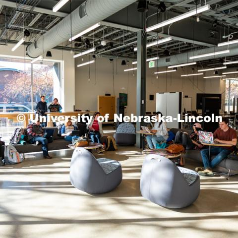 Students Hanging out by the large windows in the Johnny Carson School for Emerging Media Arts. November 12, 2019. Photo by Justin Mohling / University Communication.
