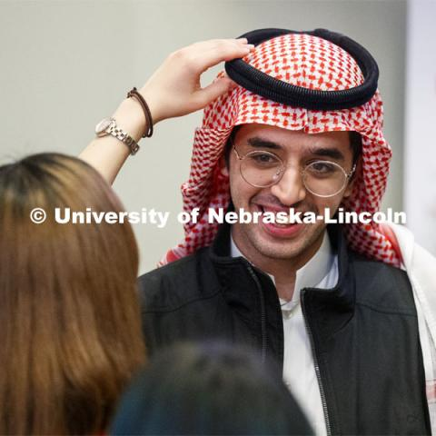 Abraham Al-Quasen, an international student from Saudi Arabia, has his headdress adjusted at the festival. Global Huskers Festival, a multicultural festival provides attendees the chance to explore the world through informational booths that will have food, cultural décor, art, and more, each hosted by UNL students from those culture. November 19, 2019. Photo by Craig Chandler / University Communication.