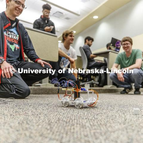 Students in Mark Bauer ECEN 102 - Introduction to Electrical Engineering class work on small robots they build and program to deliver a plastic cube along a specific path. November 20, 2019. Photo by Craig Chandler / University Communication.