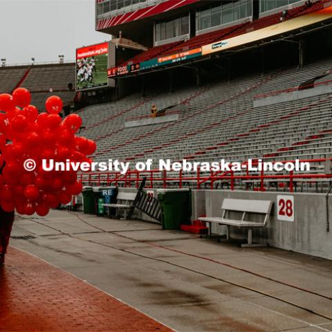Getting first touchdown ballons ready for game. Nebraska vs. Iowa State University football game. November 29, 2019. Photo by Justin Mohling / University Communication.
