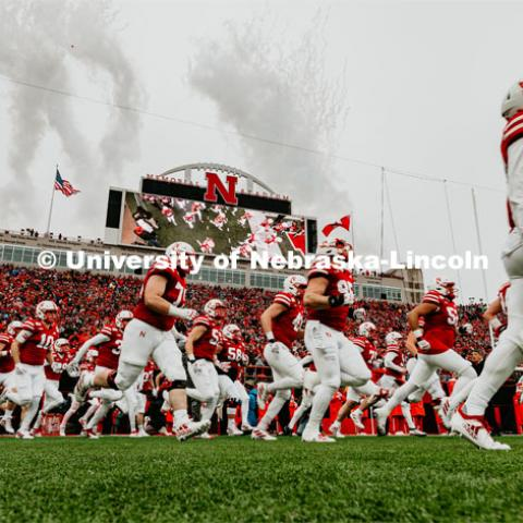 The Husker football team running onto the field at the Nebraska vs. Iowa State University football game. November 29, 2019. Photo by Justin Mohling / University Communication.