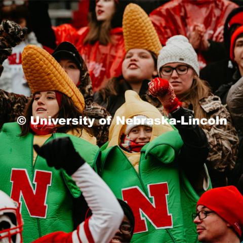 Students dancing, dressed like corn. Nebraska vs. Iowa State University football game. November 29, 2019. Photo by Justin Mohling / University Communication.