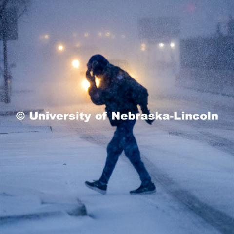 Some Mondays are more Monday than others. Monday morning snowstorm. Person crossing the street in a snow storm. December 9, 2019. Photo by Craig Chandler / University Communication.