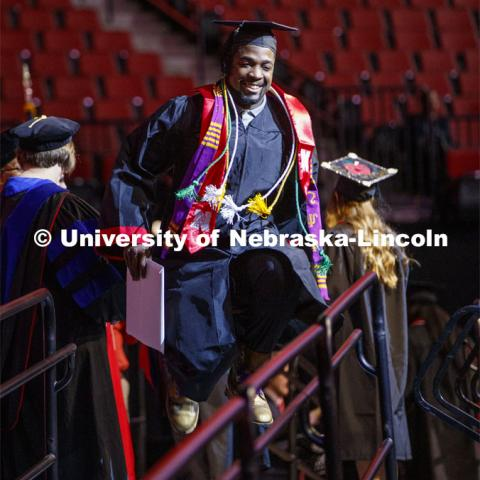 Pernell Jefferson celebrates by jumping for joy after he receives his CEHS degree. December Undergraduate commencement at Pinnacle Bank Arena. December 21, 2019. Photo by Craig Chandler / University Communication.