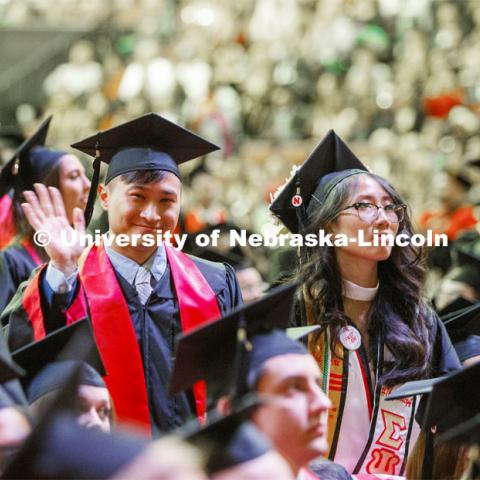 David Nguyen waves to his family. December Undergraduate commencement at Pinnacle Bank Arena. December 21, 2019. Photo by Craig Chandler / University Communication.