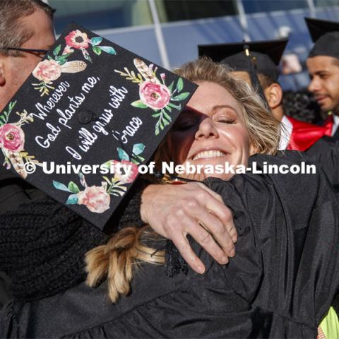 Alyssa Arndt is hugged by her mom, Jen, after the commencement. December Undergraduate commencement at Pinnacle Bank Arena. December 21, 2019. Photo by Craig Chandler / University Communication.