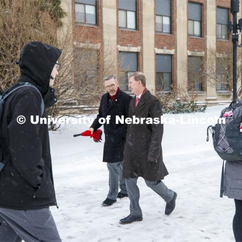 UNL Chancellor Ronnie Green and NU President Ted Carter walk across city campus during a winter-wind tour of UNL. January 17, 2020. Photo by Craig Chandler / University Communication.