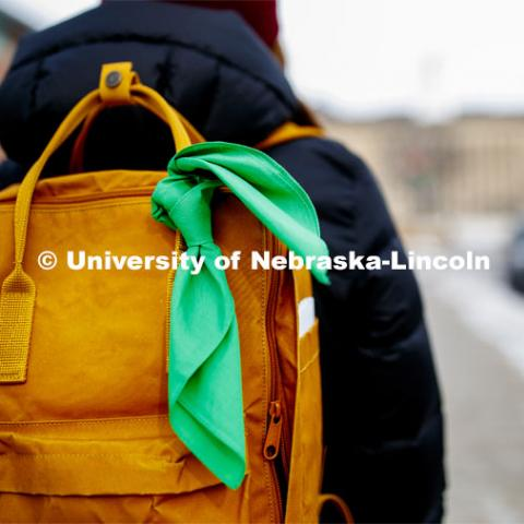 A new campaign, the Bandana Project, will launch at the University of Nebraska—Lincoln to provoke conversations about mental health and promote resources available to help students. Camille Paddock wears a green bandana on her backpack to show support for mental health awareness. The Bandana Project is a program designed to spread awareness of resources for those with mental illness. Green bandanas are attached to students' backpacks. This indicates that they are a safe individual to approach with mental health-related issues, that they know where resources are, and that they hold a few resource cards. January 21, 2020. Photo by Craig Chandler / University Communication.