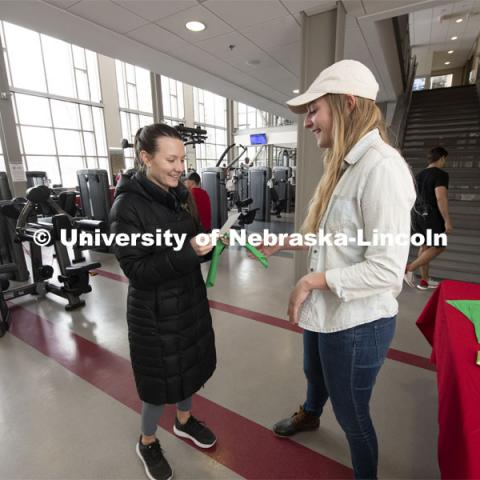 The Bandana Project is a new campaign at UNL. The bandanas are being given out to promote mental health awareness on campus. Alex Otto from Omaha discusses the program to Jamie Foote. January 29, 2020. Photo by Gregory Nathan / University Communication.