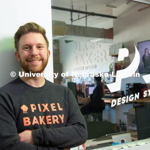 Nebraska alum Jordan Lambrecht stands outside Pixel Bakery Design Studio, which he co-founded in 2015. Lambrecht started the business with two classmates he met in Jacht, the University of Nebraska–Lincoln's student-run advertising agency. February 20, 2020. Photo by Greg Nathan / University Communication.