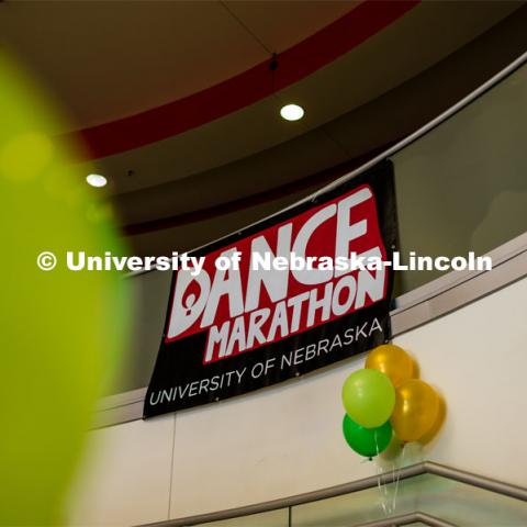 "Dance marathon sign and balloons adorn the stairwell in the Nebraska Union. University of Nebraska–Lincoln students exceeded their goal, raising $235,229 during the annual HuskerThon on Feb. 29. Also known as Dance Marathon, the event is part of a nationwide fundraiser supporting Children's Miracle Network Hospitals. The annual event, which launched in 2006, is the largest student philanthropic event on campus. The mission of the event encourages participants to, ""dance for those who can't."" All funds collected by the Huskers benefit the Children's Hospital and Medical Center in Omaha. February 29, 2020. Photo by Justin Mohling / University Communication."