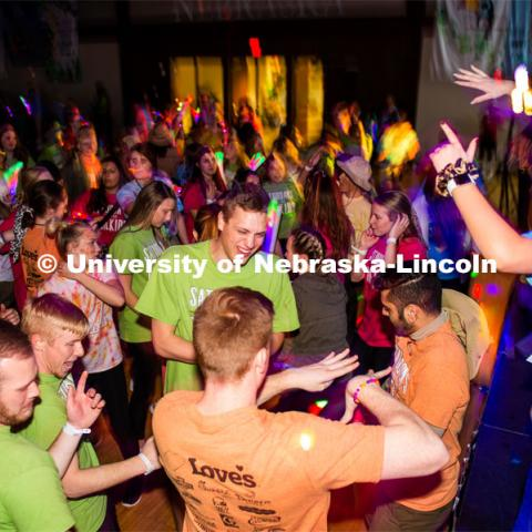 "Students dancing in a ""Rave""-like setting with glow lights and beach balls bouncing through the crowd. University of Nebraska–Lincoln students exceeded their goal, raising $235,229 during the annual HuskerThon on Feb. 29. Also known as Dance Marathon, the event is part of a nationwide fundraiser supporting Children's Miracle Network Hospitals. The annual event, which launched in 2006, is the largest student philanthropic event on campus. The mission of the event encourages participants to, ""dance for those who can't."" All funds collected by the Huskers benefit the Children's Hospital and Medical Center in Omaha. February 29, 2020. Photo by Justin Mohling / University Communication."
