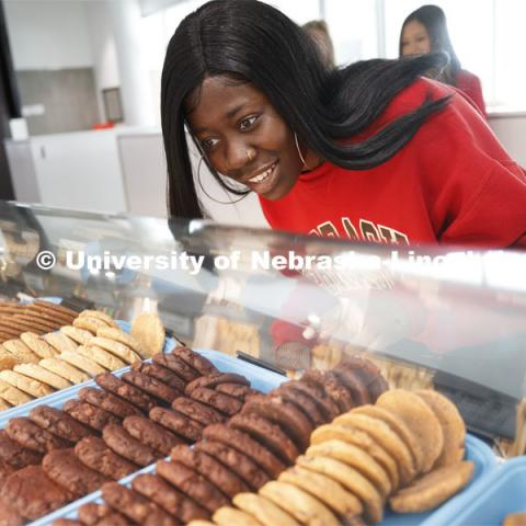 Cather Dining Center photoshoot. A young woman choosing a cookie. March 2, 2020 Photo by Craig Chandler / University Communication.