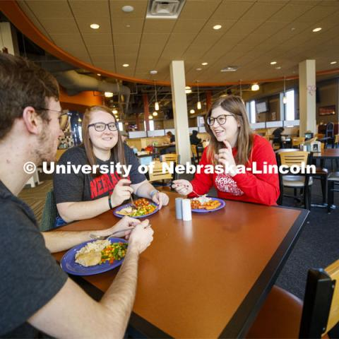 Harper Dining Center photo shoot. Students visit while enjoying their meal at Harper Dining Center. March 3, 2020. Photo by Craig Chandler / University Communication.