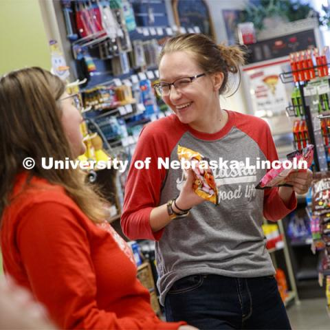 Harper Dining Center photo shoot. Young women buying snacks at Herbie's Market. March 3, 2020. Photo by Craig Chandler / University Communication.