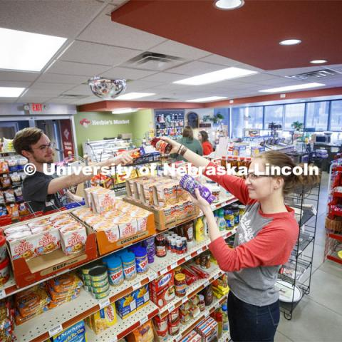Harper Dining Center photo shoot. Students buying snacks at Herbie's Market outside Harper Dining Hall. March 3, 2020. Photo by Craig Chandler / University Communication.