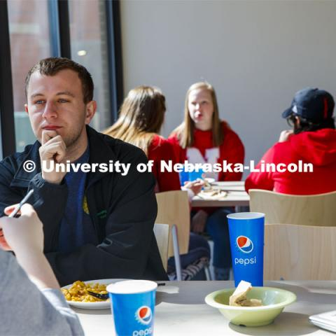 East Campus Dining Center photo shoot. Students eating and socializing at the East Campus Dining Center. March 6, 2020. Photo by Craig Chandler / University Communication.
