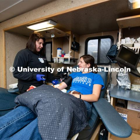 Heidi, of the Community Blood Bank, preps Fina Choat of St Edward, a Senior Pre-Veterinary Medicine Student, to donate blood. March 9, 2020. Photo by Gregory Nathan / University Communication.