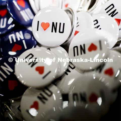 NU Advocacy Day at the Capitol. A pile of I Love NU buttons. March 10, 2020. Photo by Craig Chandler / University Communication.